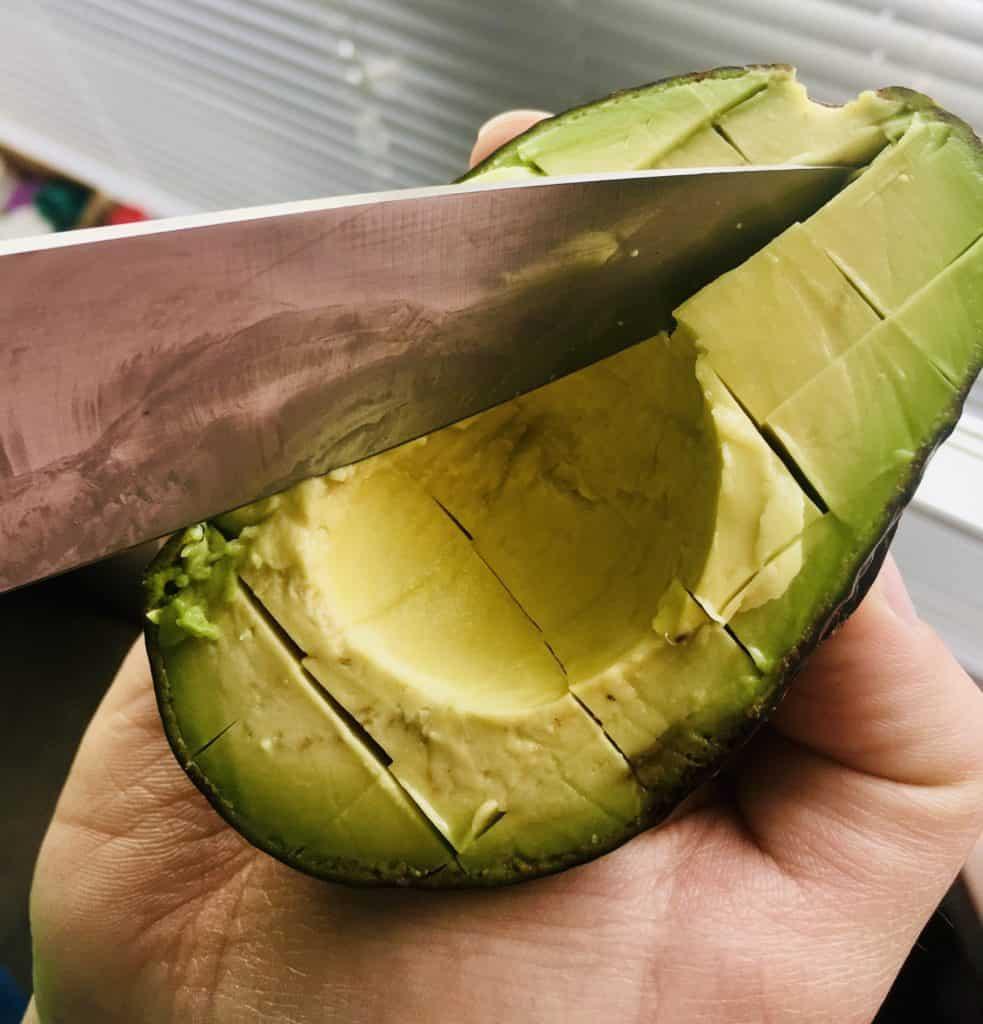 Cutting a ripe avocado