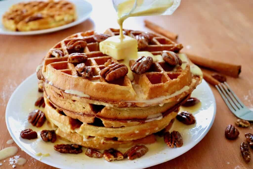 Stack of pecan waffles with cinnamon créme anglaise sauce