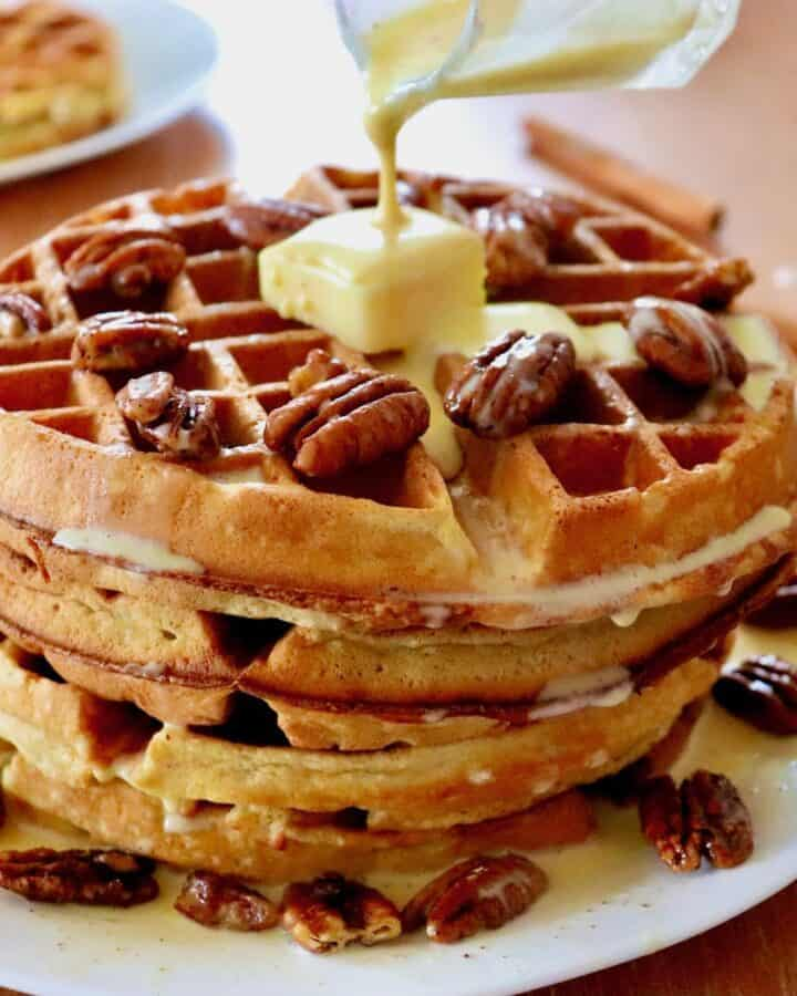 Stack of pecan waffles with créme anglaise