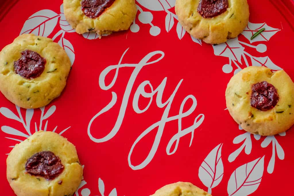 Rosemary thumbprint cookies on a red tray