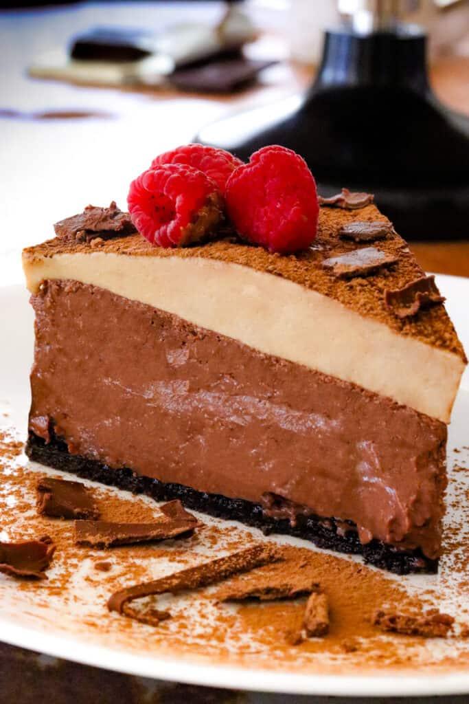Slice of espresso chocolate cheesecake on plate
