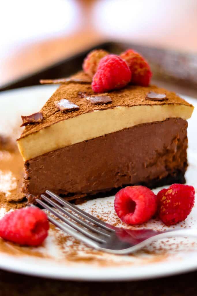 Double espresso chocolate cheesecake garnished with raspberries
