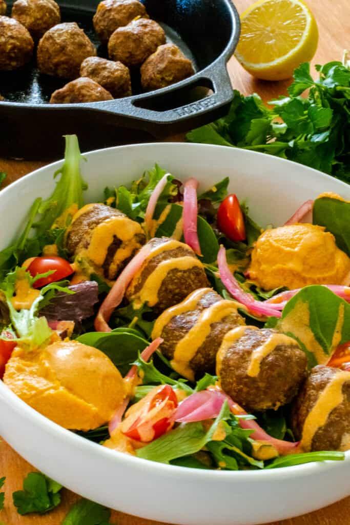 Meatball salad with harissa yogurt dressing