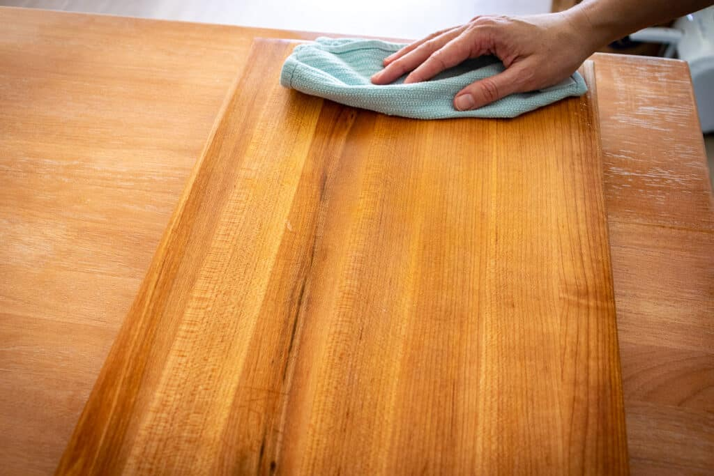 Drying a wood cutting board with a towel