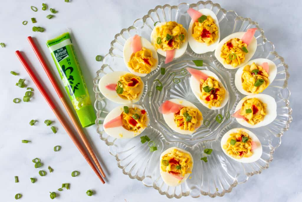 Decorative plate of wasabi deviled eggs with chopsticks and wasabi tube